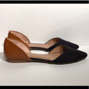 Brown and black pointed toe flats